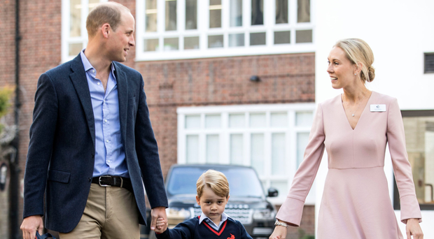 Prince George holding hands with the Duke of Cambridge and Helen Haslem, head of the lower school at Thomas's Battersea in London, as he starts his first day of class