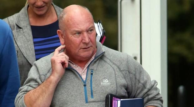 Retired businessman Neil Dymott has been given a restraining order in a dispute over a