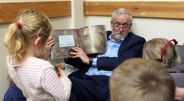 Jeremy Corbyn reading with children as he visits Brentry Children Centre in Bristol earlier this year (Steve Parsons/PA)