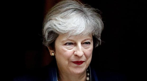 Theresa May's Tories suffer a beating in council by-elections (Frank Augstein/AP)