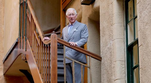 The Prince of Wales unveiled a commemorative plaque to celebrate the completion of a £6 million project to restore historic Riddle's Court in Edinburgh (Jane Barlow/PA)