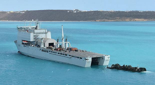 A British naval ship spearheading the humanitarian response to Hurricane Irma will remain in the Caribbean