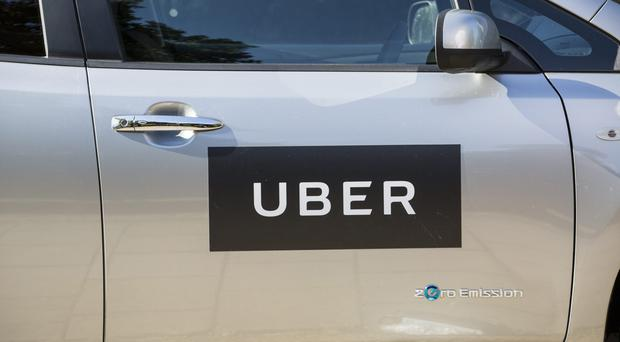 Uber is adding a surcharge to its fares to help pay for cleaner vehicles (Laura Dale/PA)