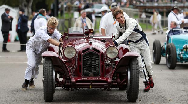 An Alfa Romeo 8C 2300 Monza is pushed back to the paddock (Andrew Matthews/PA)