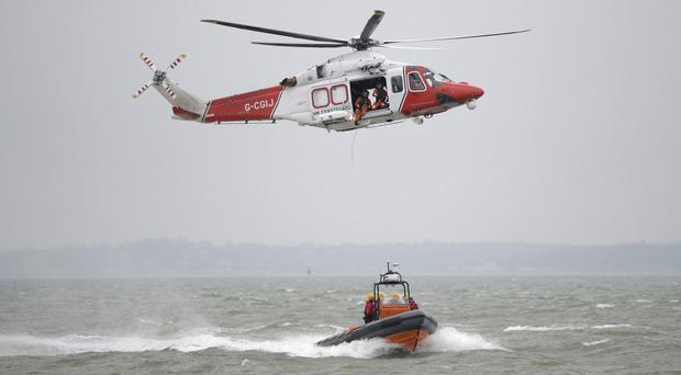 Body found in search for one of two brothers swept into sea in Cornwall (PA Archive)