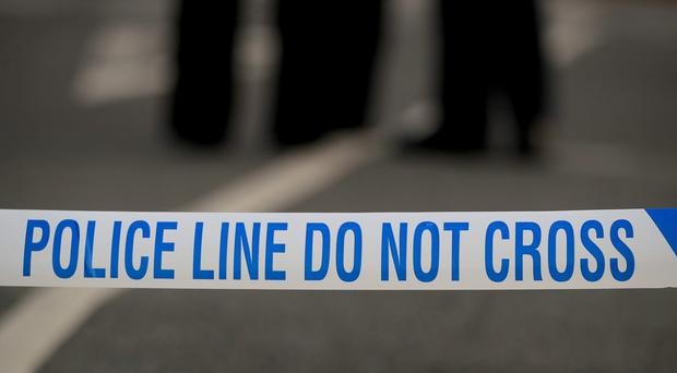 Detectives are investigating the assault of a woman who was pushed in front of a London bus by a jogger (Peter Byrne/PA)