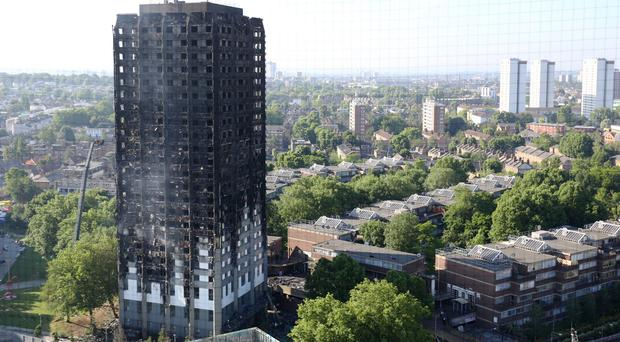 At least 80 people died in the Grenfell Tower fire (Rick Findler/PA)