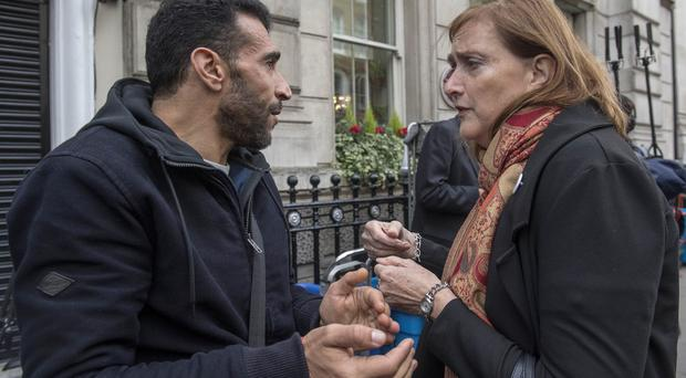Sid-Ali Atmani, resident and survivor of Grenfell Tower, talks with Emma Dent Coad, MP for Kensington, after the first preliminary hearing in the Grenfell Tower public inquiry (Victoria Jones/PA)