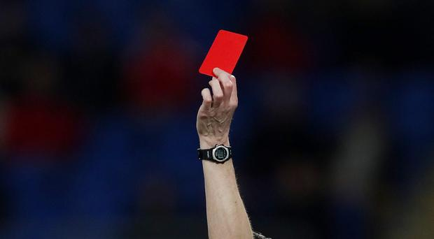 Social media companies should have a system of yellow and red cards to stop people using the platforms to perpetrate abuse, an MP has suggested