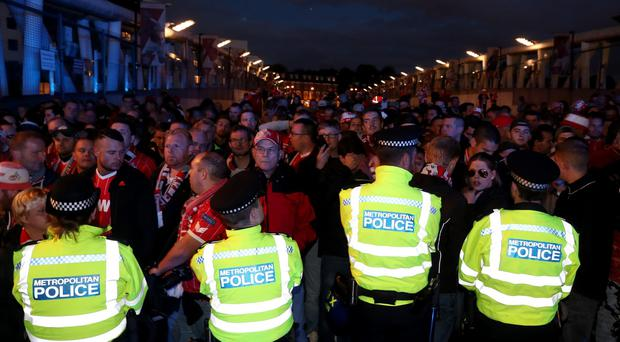 FC Koln fans and police outside the stadium prior to the Europa League match at the Emirates Stadium, London (Nick Potts/PA)