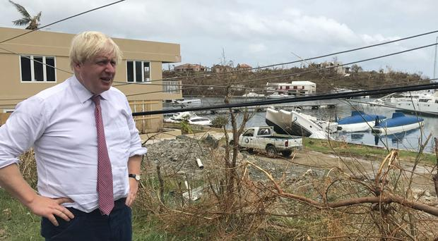 Foreign Secretary Boris Johnson surveys the damage in Tortola in the British Virgin Islands after Hurricane Irma battered the region (Georgina Stubbs/PA)