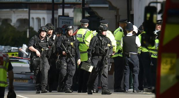 Armed police close to Parsons Green station in west London (PA)