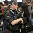 Armed police officers at Euston Station, London, after a terrorist incident was declared following a blast which sent a