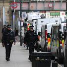 Police activity outside Parsons Green station. (PA)