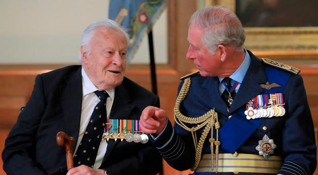The Prince of Wales talks to Battle of Britain veteran Squadron Leader Geoffrey Wellum during a reception following the service