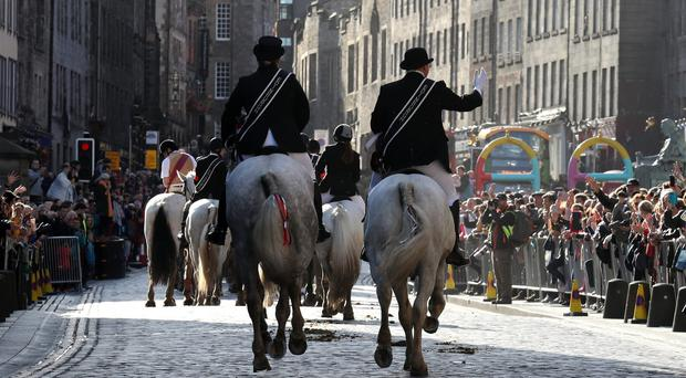 Hundreds of horses and their riders form a cavalcade on Edinburgh's Royal Mile for the Riding of the Marches, a re-enactment of the return of the Captain of the Trained Band to the city with the tragic news of defeat at the battle of Flodden in 1513 (Andrew Milligan/PA)
