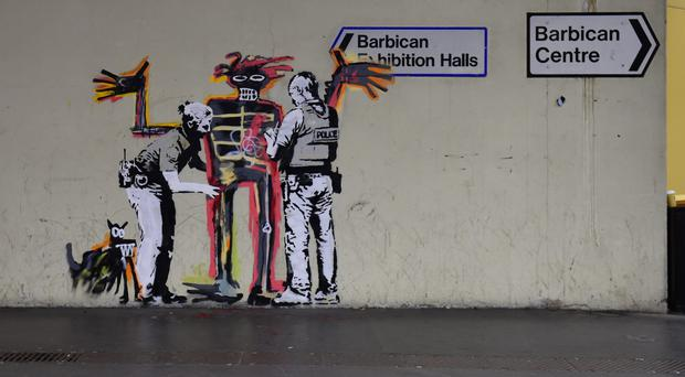 The second mural bears a likeness to Basquiat's 1982 work Boy and Dog in a Johnnypump (David Mirzoeff/PA)