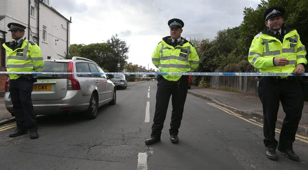 Police officers taking part in an operation in Cavendish Road, Sunbury-on-Thames (Jonathan Brady/PA)