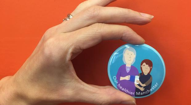 The new badge launched by Girlguides in Manchester to tackle loneliness in old people (MHCC/PA)