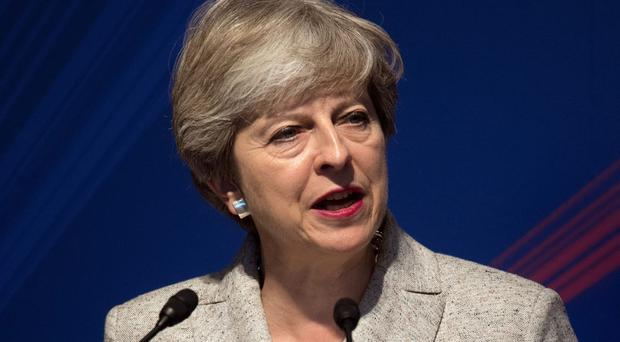 Theresa May is making a one-day visit to Canada (Carl Court/PA)