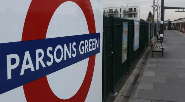 A train pulls in to the platform at Parsons Green tube station (Kirsty Wigglesworth/AP)