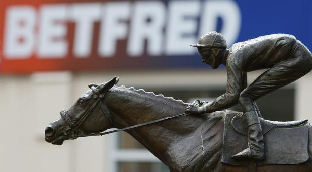 Betfred staff became concerned when the pensioner did not turn up for several days (Dave Thompson/PA)