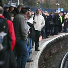 Commuters wait on a platform (Gareth Fuller/PA)