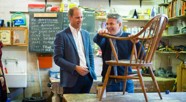 Prince William talks with volunteer Bernard Bristow during his visit to the Spitalfields Crypt Trust