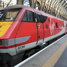 Virgin East Coast passengers will be able to bid for first class upgrades from £5 via an app (Martin Keene/PA)