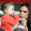 Victoria Beckham with daughter Harper (Adam Davy/EMPICS Sport)