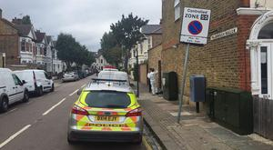 A man and woman have been arrested on suspicion of murder after a badly burned body was found in a garden in Southfields, south-west London (Ryan Hooper/PA)