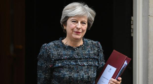 Theresa May will remind European leaders they have a 'profound sense of responsibility' to agree good terms (Stefan Rousseau/PA)