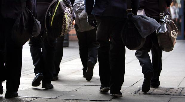 Almost half of parents polled said they are concerned about the price of school uniforms (David Jones/PA)