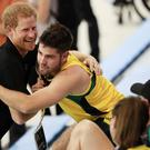 Prince Harry embraces one of the Invictus athletes during a training session at the Toronto Pan Am Sports Centre (Danny Lawson/PA)