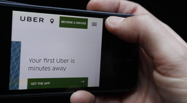 An Uber driver believes 40,000 will be left unemployed in the wake of TfL's decision not to renew the company's licence in London (Kirsty Wigglesworth/AP)