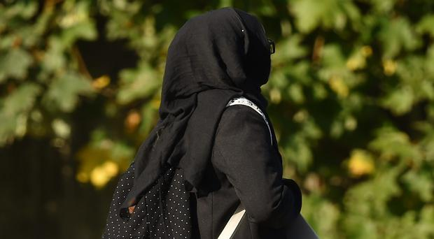 More than two in five Islamic schools in England that accept girls require them to wear a hijab as school uniform, according to new research (Joe Giddens/PA)