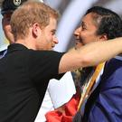 Prince Harry presents athletes with medals at the 2017 Invictus Games (Danny Lawson/PA)