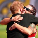 Prince Harry hugs gold medallist Sarah Rudder at the Invictus Games