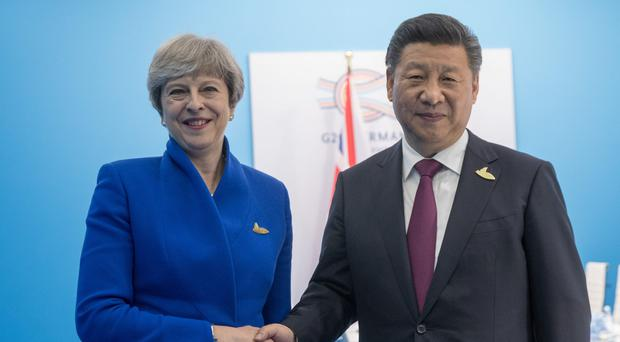 Theresa May spoke with Chinese president Xi Jinping on the telephone and agreed a diplomatic solution must be found to the North Korea crisis (Matt Cardy/PA)