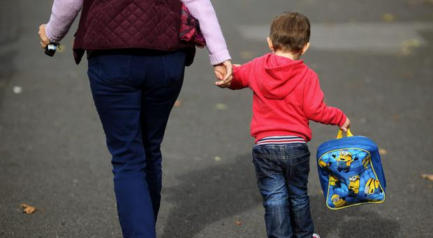 Data shows there are 4.9 million mothers with dependent children in employment (Niall Carson/PA)