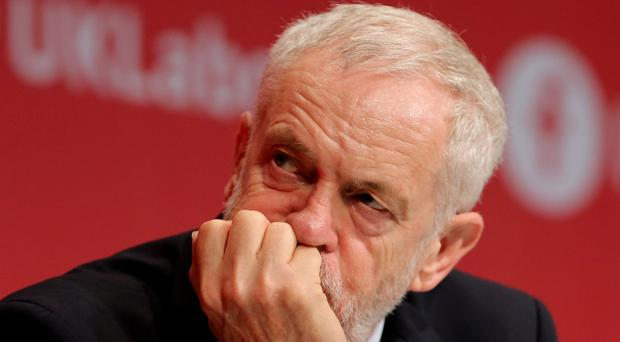 Jeremy Corbyn has been urged to ensure Labour backs tough new rules on anti-Semitism after controversial comments were made by an American author at a fringe meeting ( Stefan Rousseau/PA)