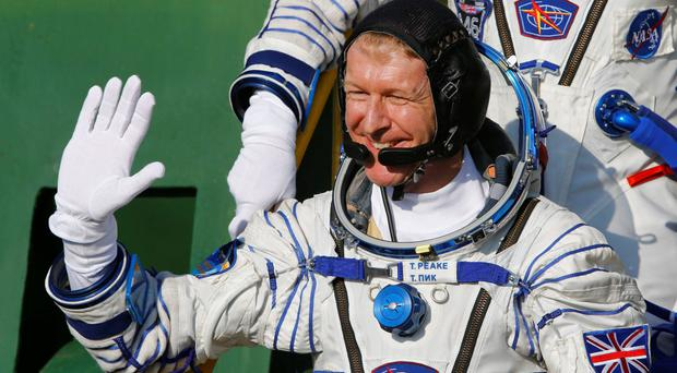 Tim Peake boards the Soyuz TMA-19M spacecraft at the Baikonur cosmodrome, prior to blasting off to the International Space Station in 2015