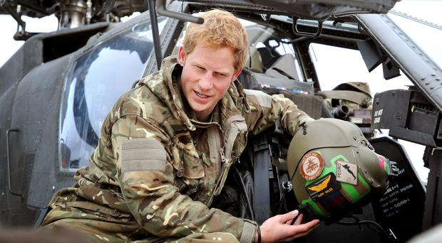 Prince Harry making early morning pre-flight checks at Camp Bastion in southern Afghanistan (John Stillwell/PA)