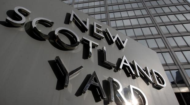 A woman has been arrested by Scotland Yard's counter-terrorism command on suspicion of an offence under the Official Secrets Act (Dominic Lipinski/PA)