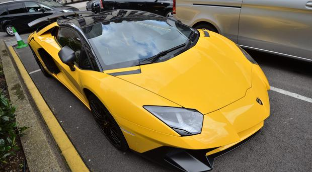 Lamborghini, Ferrari and Rolls-Royce owners were among thousands of drivers who had their vehicles seized for avoiding road tax last year (John Stillwell/PA)