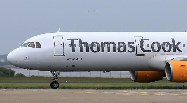 A planned strike on Friday by pilots at Thomas Cook in a dispute over pay has been called off ( Tim Goode/PA)
