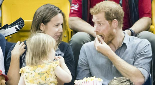Prince Harry shares his popcorn with Emily Henson (Danny Lawson/PA)