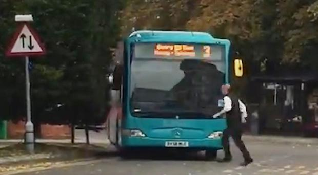 An investigation has been launched after an empty bus rolled backwards down a road, mounted a kerb and hit a tree (Connor Hepple/PA)