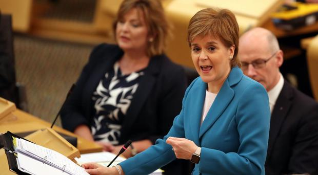 First Minister Nicola Sturgeon during First Minister's Questions at the Scottish Parliament in Edinburgh (Jane Barlow/PA)