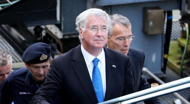 Sir Michael Fallon recommitted the UK to nuclear deterrence as he held global security talks with Nato's Secretary General Jens Stoltenberg (Jane Barlow/PA)